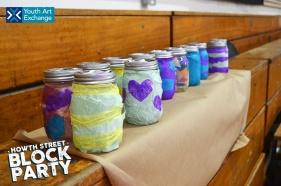 Mason jar lanterns lined up after lantern making workshops