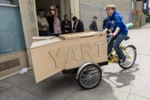 YAX Architecture students show off their mobile gallery/workshop station/art cart.