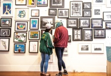 YAX youth check out their prints and photographs in the gallery at Root Division