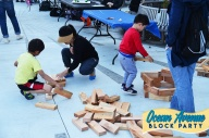 kids building with wooden blocks at Ocean Avenue Block Party