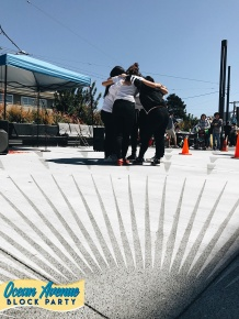Youth Art Exchange dance team huddle at Ocean Avenue Block Party