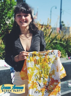 youth showing off tie-dyed shirt at Ocean Avenue Block Party